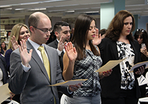 Group of individuals raising their hand while giving an oath